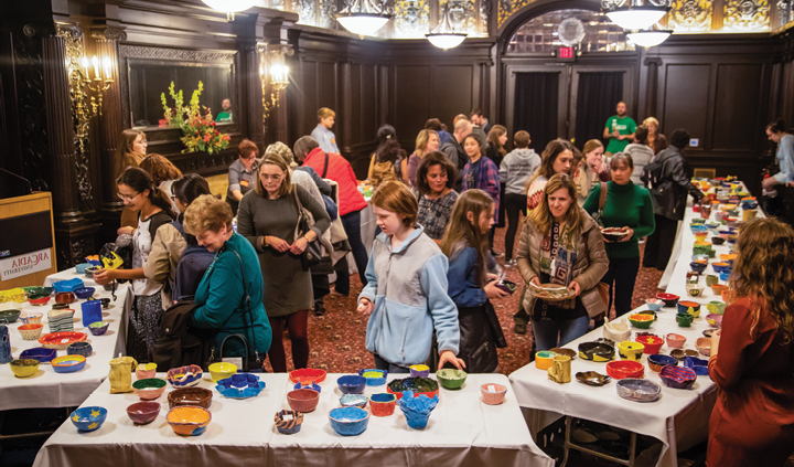 Attendees select their bowls at last year's annual Empty Bowl Dinner.