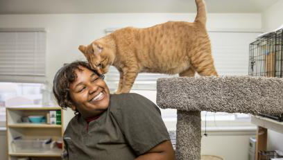 Student at her off-campus job at an animal rescue