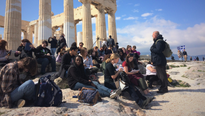 Professor teaching a group of students at the ruins in Athens
